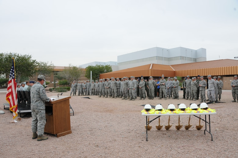 Airmen from the 161st Air Refueling Wing gather for a ground breaking ceremony for the Base Fitness Center, Nov.14 here at Phoenix Sky Harbor Air National Guard Base. The 2,400 square foot fitness center, which is scheduled to open in approximately six months, will provide Airmen twice the square footage of the existing facility, add daylighting features, industrial architecture finishes, 20 foot vaulted ceilings and reverse osmosis drinking water. (U. S. Air National Guard photo by Master Sgt. Kelly M. Deitloff/Released)