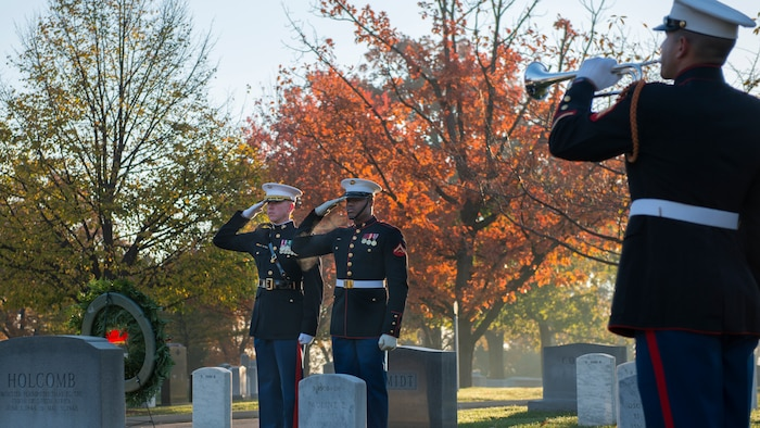 Maj. Paul Steketee, adjutant at Marine Barracks Wahington, D.C., and Lance Cpl. Anthony Hill, body bearer, Bravo Co., Marine Barracks Washington, D.C., salute as Sgt. Jason Pena, bugler with The United States Drum and Bugle Corps, plays taps at the grave site of Gen. Thomas Holcomb the 17th commandant of the Marine Corps in Arlington National Cemetery, Arlington, Virginia, Nov. 10, 2014. Holcomb served as the commandant of the Marine Corps from 1936 to 1943. (U.S. Marine Corps photo by Sgt. Melissa Karnath/Released)