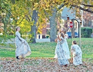 Ghostly children play in a park Oct. 26 during HASFR's Ghost Tours. The children were a few of the many ghosts reenacted for the walking tour through historical main post.