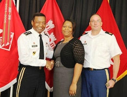 Lt. Gen. Thomas P. Bostick (left) and Command Sgt. Maj. Karl J. Groninger (right) recognizing Ms. Wiseman-Bell at the USACE Summer Leaders Conference.