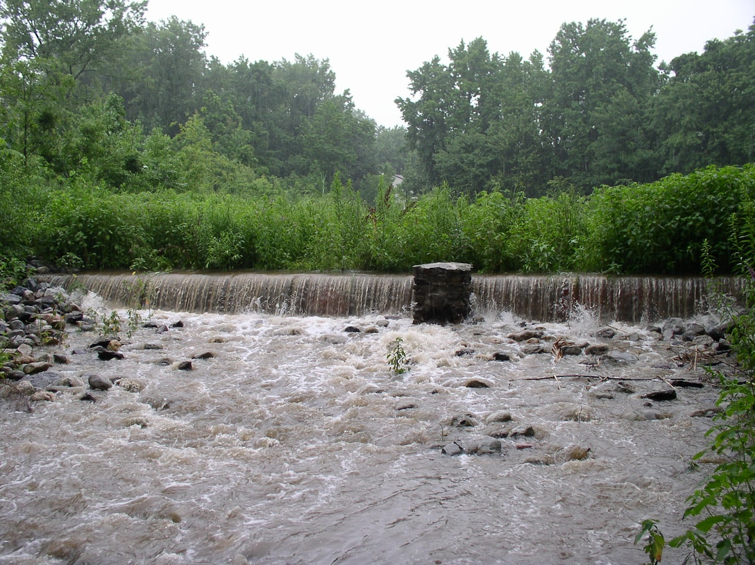 Water flows over a weir in Arbutus Creek, where the NYCDEP maintains a system of best management practices for stormwater control and conveyance.