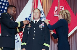 (Then) Col. Jeffrey L. Milhorn, commander, U.S. Army Corps of Engineers-Pacific Ocean Division, is pinned with his first star at a frocking ceremony, Oct. 30, by Lt. Gen. Thomas Bostick, USACE commander and 53rd Chief of Engineers, and his wife, Debbie, at USACE headquarters. The Army Corps' newest brigadier general is responsible for executing the USACE mission throughout the Indo-Asia-Pacific region.
