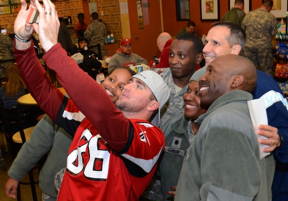 Atlanta Falcons player Bear Pascoe, shoots a selfie with Air Force service members at the Dobbins ARB base exchange in Marietta, Georgia, Nov. 18, 2014. Falcons players spent a couple of hours on the base to thank the various military service members assigned for what they do every day for our country.  (U.S. Air Force photo/ Brad Fallin /Released)