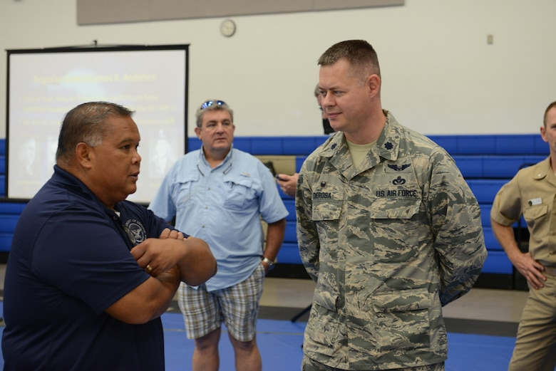 Lt Col. Andrew Derosa, 554th RED HORSE Squadron commander, interacts with retirees at the Coral Reef Fitness Center Nov. 15 2014 on Andersen Air Force Base Guam. The retirees shared stories from their time served in the Armed Forces with active duty military members in attendance. (U.S. Air Force Photo by Senior Airman Adarius Petty.)