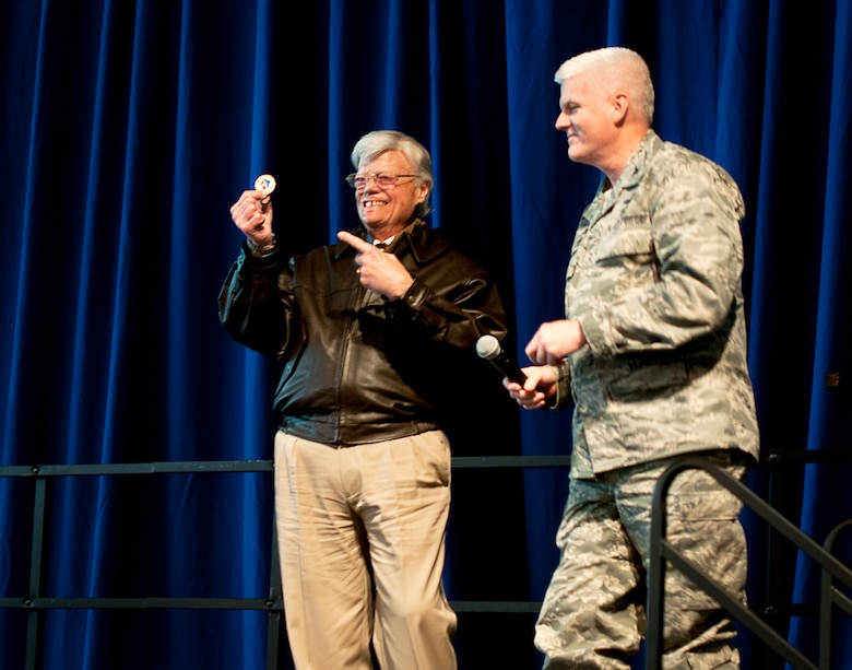 U.S. Air Force Col. James Johnson, Commander of the 133rd Airlift Wing, gives Mr. Dave Roever, a Navy Vietnam Veteran, a unit coin after Roever shared his story on resilience in St. Paul, Minn., Dec. 15, 2014. Roever triumphed over both physical and mental obstacles in his life and is shared his experience with Airmen from the 133rd Airlift Wing.  (U.S. Air National Guard photo by Staff Sgt. Austen Adriaens/Released)