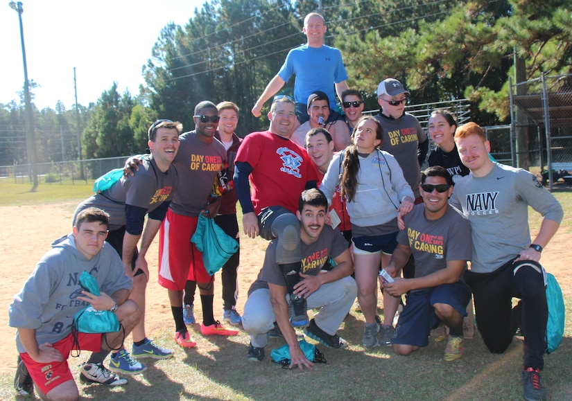 The Pitch Vibe team, made up of Naval Nuclear Power Training Command staff officers, took home the trophy at the 4th Annual Sexual Assault Prevention and Response Kickball Tournament Nov. 15, 2014, at Locklear Park on Joint Base Charleston, S.C. More than 20 teams participated in the event designed to raise awareness and promote efforts to prevent sexual assault. (U.S. Navy photo/Petty Officer 2nd Class Jason Pastrick)