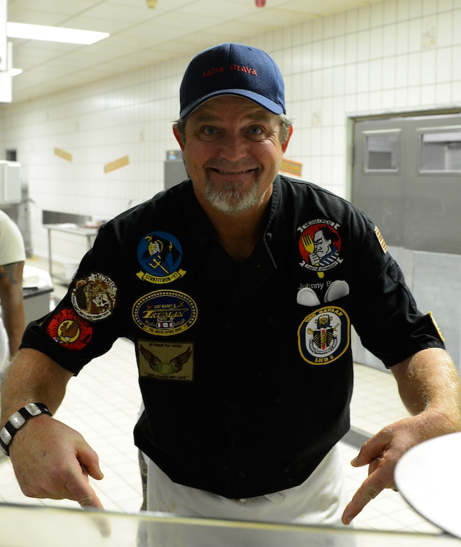 "John Conley, owner and chef at Salsa Brava Mexican Grill in Flagstff, Ariz., smiles as he points to the grill during the ""Messlords"" luncheon at the Mosel Dining Facility at Spangdahlem Air Base, Germany, Nov. 15, 2014. His restaurant was featured on Food Network's show ""Diners, Drive-ins, and Dives"" with host Guy Fieri. (U.S. Air Force photo by Airman 1st Class Luke Kitterman/Released)"
