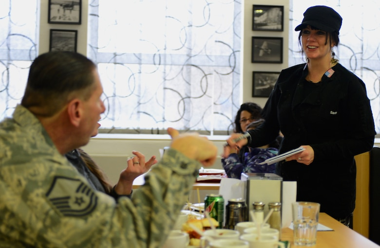 "Sarah Simington, owner and chef at Blue Moon Café in Baltimore, talks with attendees of the ""Messlords"" luncheon at the Mosel Dining Facility at Spangdahlem Air Base, Germany, Nov. 15, 2014. Since 2011, Simington has been cooking for various military bases in Europe. (U.S. Air Force photo by Airman 1st Class Luke Kitterman/Released)"