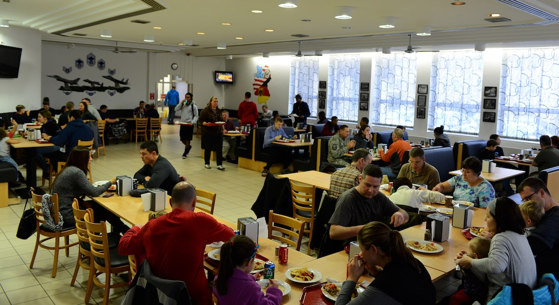 """Members of the Spangdahlem community eat lunch at the Mosel Dining Facility during the """"Messlords"""" luncheon at Spangdahlem Air Base, Germany, Nov. 15, 2014. The free luncheon went from noon to 2 p.m. and was open to the entire base. (U.S. Air Force photo by Airman 1st Class Luke Kitterman/Released)"""