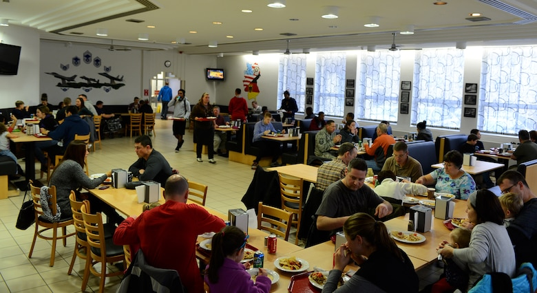 "Members of the Spangdahlem community eat lunch at the Mosel Dining Facility during the ""Messlords"" luncheon at Spangdahlem Air Base, Germany, Nov. 15, 2014. The free luncheon went from noon to 2 p.m. and was open to the entire base. (U.S. Air Force photo by Airman 1st Class Luke Kitterman/Released)"