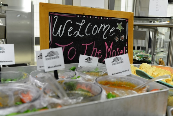 """A welcome sign sits next to an assortment of salsas for the """"Messlords"""" luncheon at the Mosel Dining Facility on Spangdahlem Air Base, Germany, Nov. 15, 2014. """"Messlords"""" are a group of chefs who entertain and cook for U.S. service members around the world. (U.S. Air Force photo by Airman 1st Class Luke Kitterman/Released)"""
