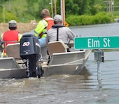 U.S. Army Corps of Engineers and North Dakota Game and Fish officials tour flooded areas in Burlington, North Dakota, June 30, 2011.