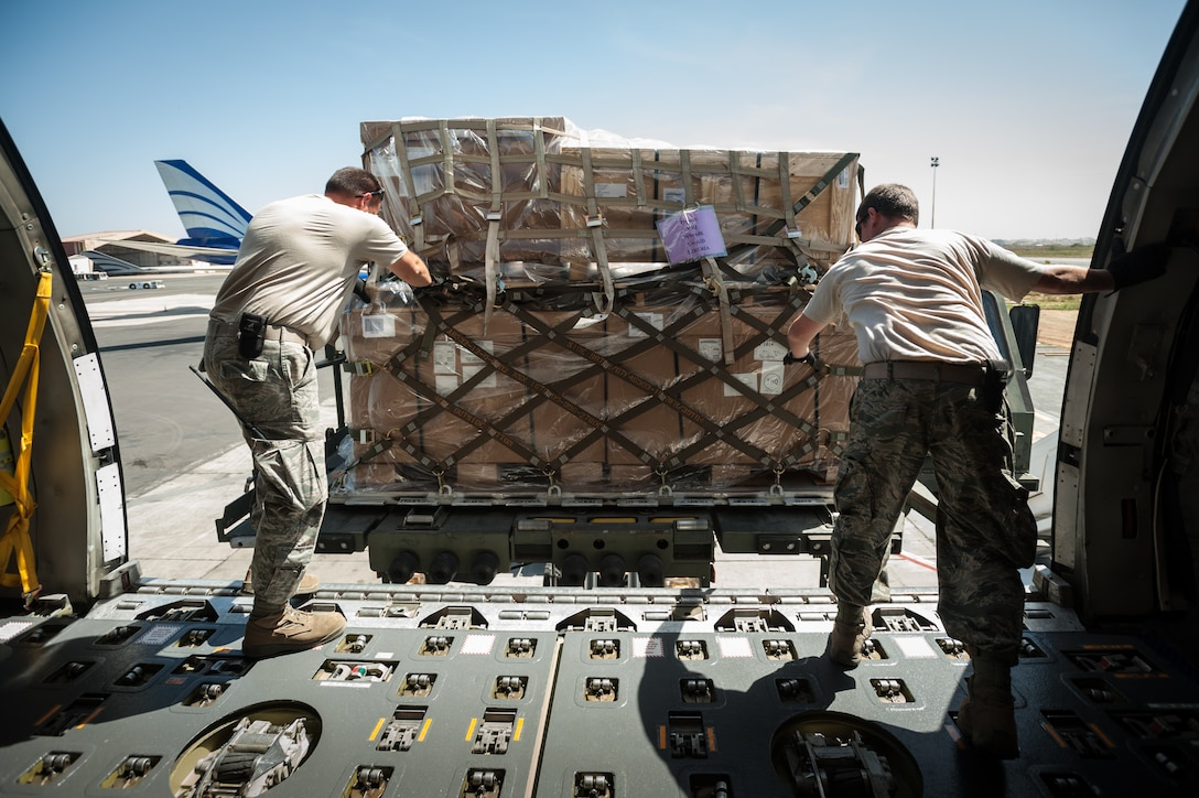 Aerial porters from the Kentucky Air National Guard's 123rd Contingency Response Group offload pallets of humanitarian aid from a KC-10 Extender onto a Halverson cargo-handling vehicle Nov. 12, 2014, at the Léopold Sédar Senghor International Airport in Dakar, Senegal. The Kentucky Airmen will stage the cargo in Senegal before transferring it to C-130J Super Hercules for delivery into Monrovia, Liberia, in support of Operation United Assistance, the U.S. Agency for International Development-led, whole-of-government effort to contain the Ebola virus outbreak in West Africa. (U.S. Air National Guard photo/Maj. Dale Greer)