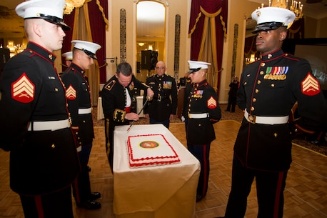 Maj. Charles D. Godwin cuts the Marine Corps birthday cake during Recruiting Station Milwaukee's Birthday Ball ceremony in Milwaukee, Wis., Nov. 15, 2014.  The birthday cake is passed from the oldest to the youngest Marine present, symbolizing the passing of history and traditions to the next generation.