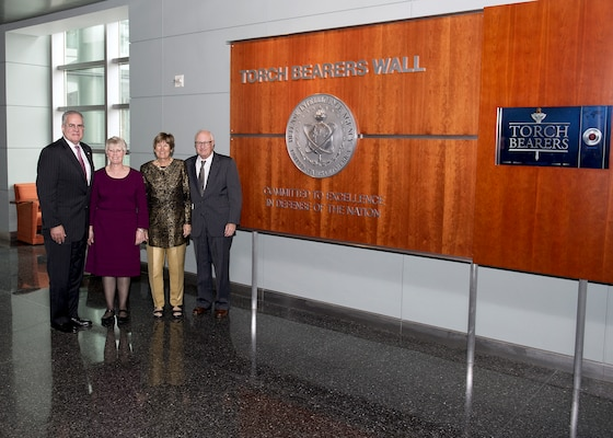 DIA Acting Director David Shedd and his wife, Lisa, stand with newly inducted Torch Bearer Margaret Munson and her husband, Michael, at DIA Headquarters Nov. 13.