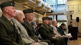 "Retired Col. James ""Rip"" Harper (second from left) and Brig. Gen. Patrick Hermesmann, commanding general of 4th Marine Logistics Group (third from left), observe the 6th Engineer Support Battalion's battle color rededication ceremony in Portland, Ore., Nov. 15, 2014.The battalion celebrated the 70th anniversary of its formation with a rededication ceremony and paid homage to Harper, the battalion's first adjutant. Harper served as the unit's first adjutant as a first lieutenant in 1944, when the unit was formed in Guadalcanal during World War II."