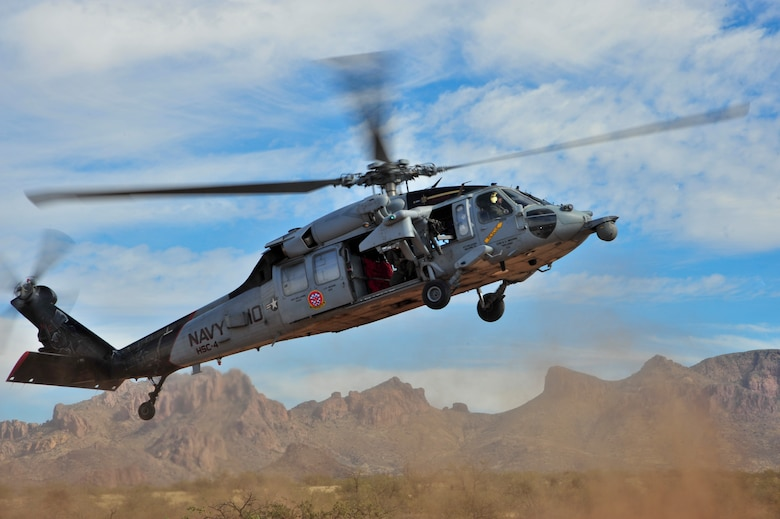 A U.S. Navy MH-60S Knighthawk from the Helicopter Sea Combat Squadron 4 Black Knights, lands at a military training range in Southern Arizona, Nov 14, 2014.  HSC-4 was detached to Davis-Monthan Air Force Base, Ariz., conducting joint operations training with A-10C Thunderbolt II squadrons and Combat Search and Rescue units.  (U.S. Air Force Photo by Airman 1st Class Chris Massey/Released)