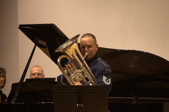 The newest member of the Ceremonial Brass, Tech. Sgt. Brandon Jones, performs a solo with Lisa Gibbs-Smith, piano, at The Lyceum in Old Town Alexandria on November 6, 2014. (U.S. Air Force photo by Tech. Sgt. Matthew Shipes)