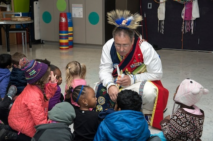 Edward Blauvelt, Joint Base San Antonio-Randolph Native American Indian Heritage Month Committee chairman, shares stories with children attending the Part Day Enrichment Program offered by the Child Development Program Nov. 14, 2014 at Joint Base San Antonio-Randolph's Youth Center. The storytelling session at the youth center allowed him to communicate information on Native American Indian culture and pass on their stories. Throughout November, the nation will celebrate National Native American Indian Heritage Month. The month is set aside to recognize the significant contributions Native American Indians have made to the establishment and growth of the United States in the past and are still doing today. (U.S. Air Force photo by Johnny Saldivar)