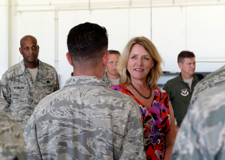 Secretary of the Air Force Deborah Lee James learns about RQ-4A Global Hawk mission capabilities from talking with 69th Reconnaissance Squadron, Detachment 2 Airmen Nov. 19, 2014, at Andersen Air Force Base, Guam. The secretary met and discussed Air Force policies and goals with Airmen and local community leaders during her two-day visit to Andersen and received a firsthand look at the base's critical role in the strategic Pacific rebalance. (U.S. Air Force photo/Airman 1st Class Amanda Morris)