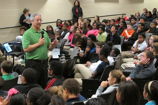 John Trudell speaks to more than 250 students during a GIS Day STEM event at Williams Middle School Nov. 19.