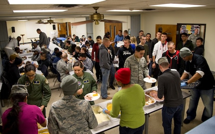 Joint Base San Antonio-Randolph single enlisted Airmen mingle and enjoy a hot Thanksgiving meal provided by the JBSA-Randolph Top 3 Nov. 13 at the JBSA-Randolph Chapel Center. (U.S. Air Force photo by Airman 1st Class Alexandria Slade)