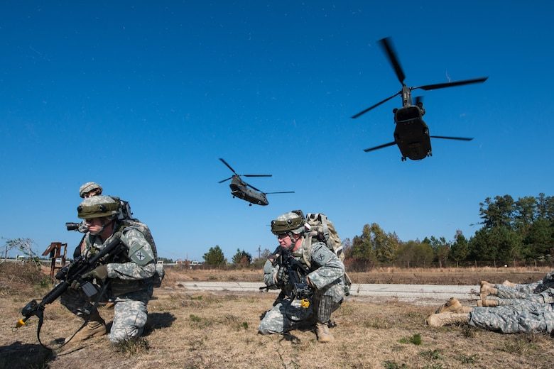 U.S. Army Soldiers, assigned to the 1-118th Combined Arms Battalion, South Carolina Army National Guard, dismount CH-47 Chinooks during an assault on the Savannah River Site, Aiken, S.C., as part of Carolina Thunder 14, Nov. 15, 2014. South Carolina National Guard, along with North Carolina, Georgia and Tennessee National Guard units, conducted Carolina Thunder 14, joint training exercise, on a drill weekend. More than 30 aircraft participated in the mass takeoff from McEntire Joint National Guard Base, Eastover, S.C. Units conducted air and ground operations at the Savannah River Site in Aiken, S.C. The S.C. Air National Guard 169th Fighter Wing's F-16 Fighting Falcons joined AH-64D Apaches, CH-47 Chinooks, UH-60 Black Hawks and more than 100 infantry Soldiers from the S.C. Army National Guard to train with Apaches from the N.C. Army National Guard and the Joint Surveillance Target Attack Radar System (JSATRS) and Joint Terminal Training Center (JTAC) from the Georgia Air National Guard in a collective force-on-force, enemy suppression and assault mission.