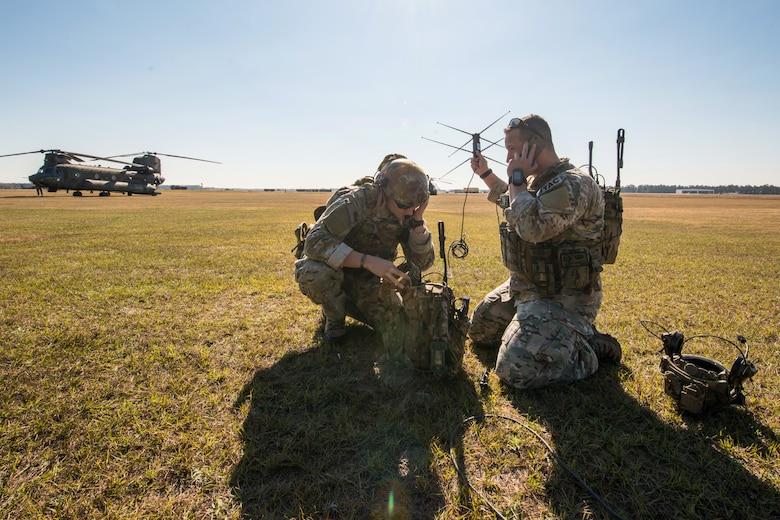 A U.S. Air Force Tactical Air Control Party, assigned to the 165th Air Support Operations Squadron, Georgia Air National Guard, establishes communications with aircraft during Carolina Thunder 14 on a drill weekend, Nov. 15, 2014. South Carolina National Guard, along with North Carolina, Georgia and Tennessee National Guard units, conducted Carolina Thunder 14, joint training exercise, on a drill weekend. More than 30 aircraft participated in the mass takeoff from McEntire Joint National Guard Base, Eastover, S.C. Units conducted air and ground operations at the Savannah River Site in Aiken, S.C. The S.C. Air National Guard 169th Fighter Wing's F-16 Fighting Falcons joined AH-64D Apaches, CH-47 Chinooks, UH-60 Black Hawks and more than 100 infantry Soldiers from the S.C. Army National Guard to train with Apaches from the N.C. Army National Guard and the Joint Surveillance Target Attack Radar System (JSATRS) and Joint Terminal Training Center (JTAC) from the Georgia Air National Guard in a collective force-on-force, enemy suppression and assault mission.