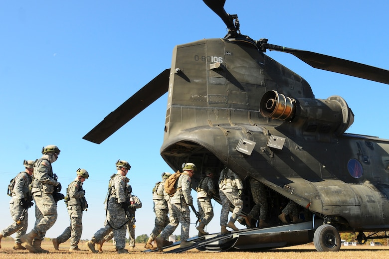"""South Carolina National Guard, along with North Carolina and Georgia National Guard units conducted """"Carolina Thunder 14"""", a drill weekend, joint training exercise Nov. 15, 2014. More than 30 aircraft participated in the mass take-off from McEntire Joint National Guard Base, Eastover, S.C. Units conducted air and ground operations at the Savannah River Site in Allendale, S.C. The S.C. Air National Guard 169th Fighter Wing's F-16 Fighting Falcons joined AH-64D Apaches, CH-47 Chinooks, UH-60 Black Hawks and more than 100 Infantry Soldiers from the S.C. Army National Guard to train with Apaches from the N.C. Army National Guard and the Joint Surveillance Target Attack Radar System (JSATRS) and Joint Terminal Training Center (JTAC) from the Georgia Air National Guard in a collective force-on-force, enemy suppression and assault mission. (U.S. Army National Guard photo by Sgt. Brian Calhoun/Released)"""