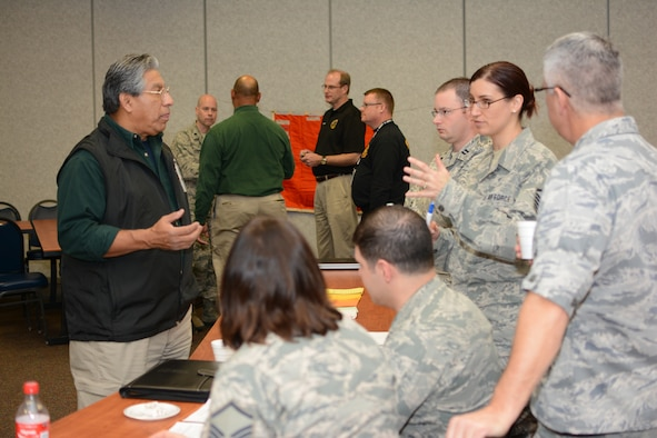 Wisconsin Air National Guard members work with Wisconsin civilian authorities during a unified reception, staging, onward movement and integration exercise at Volk Field Air National Guard Base, Camp Douglas, Wis., Nov. 19, 2014. The URSOI training and exercise event lasted three days and tested the knowledge and response capabilities of Wisconsin's civilian and military personnel during emergency situations. (U.S. Air National Guard photo by Senior Airman Andrea F. Rhode)