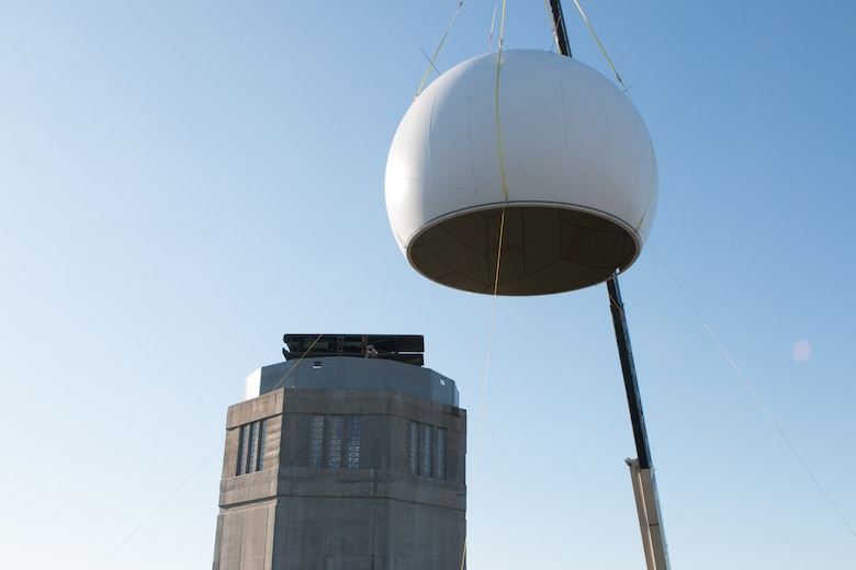 Airmen from the 103rd Air Control Squadron raise a fiber composite radome on to the radar tower at the Orange Air National Guard Station, Orange, Conn., Oct. 25, 2014.  The maintenance free radome, which gets its name from a blend of the words radar and dome, is a protective shield that encompasses a radar antenna to eliminate the need to fold and protect the $2 million antenna within from possible wind damage during severe weather.  (Photo courtesy of Senior Master Sgt. Keith Haessly)