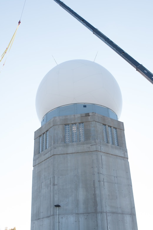 A newly installed fiber composite radome shields a tactical radar antenna at the top of the radar tower at the Orange Air National Guard Station, Orange, Conn., Oct. 25, 2014.  The maintenance-free radome is a protective shield that eliminates the need to fold and protect the $2 million antenna within from possible damage during severe weather, enabling the Airmen of the 103rd Air Control Squadron to focus on other mission priorities.  (Photo courtesy of Senior Master Sgt. Keith Haessly)