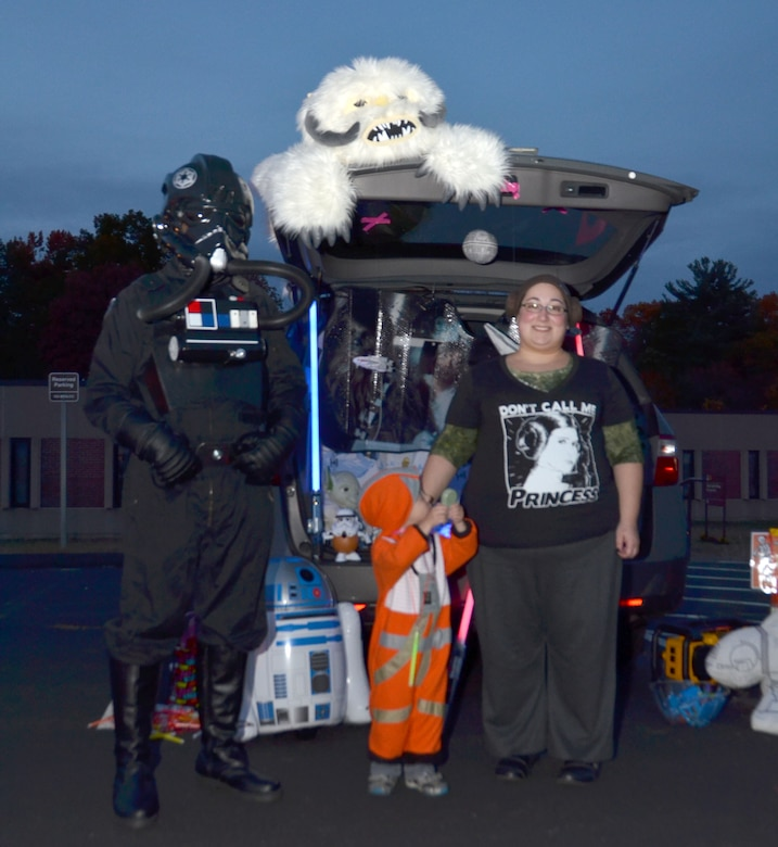 "Staff Sgt. Brian Koehler, a supply sergeant with the Connecticut Army National Guard, dressed as a ""Tie Fighter pilot"", and Jessica Koehler, family assistance center specialist, dressed in ""Princess Leia"" gear, pose with their son Owen, 4, who is dressed as an ""X-Wing Fighter pilot"" during the Child and Youth Program's Trunk or Treat event held at Bradley Air National Guard Base, East Granby, Conn., Oct. 28, 2014.  . (U.S. Air National Guard photo by Tech. Sgt. Joshua Mead)"