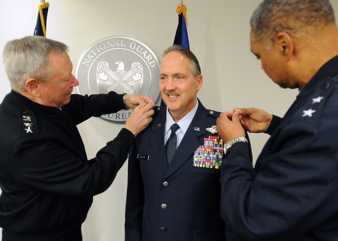 U.S. Army Gen. Frank Grass (left), chief of the National Guard Bureau, promotes Greg Nelson, vice director of Strategic Plans, Policy and International Affairs at the National Guard Bureau, to the rank of brigadier general during a ceremony at the National Guard Readiness Center in Arlington, Va., Nov. 19, 2014. Nelson served as commander of the Kentucky Air National Guard's 123rd Airlift Wing in Louisville from 2008 to 2012. (U.S. Army National Guard photo by Staff Sgt. Michelle Gonzalez)