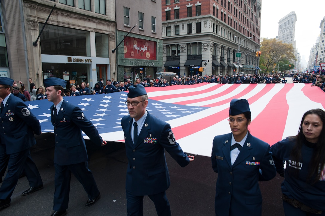 Members of the 514th Air Mobility Wing help carry the Ground Zero Flag down 5th Avenue, New York City, during the annual Veterans Day Parade there November 11. More than 30 Airmen from the wing volunteered to march in the parade which honors veterans of the past and present (US Air Force photo/Christian DeLuca)