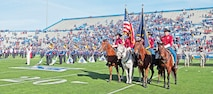 "Members of the Commanding General's Mounted Color Guard, Sgt. Kevin Lee, Sgt. Brandon Stubbs, Staff Sgt. Steven Stanley and Pfc. Benjamin Sparks, present the nation's and state's colors Nov. 8 before a football game against the University of Kansas and Iowa State University in Lawrence, Kan. The KU Jayhawks hosted a Salute to Service game in honor of Veterans Day. The CGMCG and members of the 1st Infantry Division Band represented the ""Big Red One"" at the game, which KU won, 34-14."