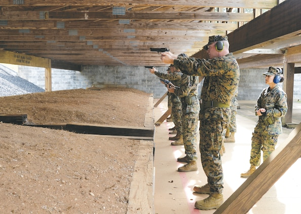 Marines take aim at updated targets during Combat Pistol Program qualifications at Marine Corps Logistics Base Albany's pistol range, recently.