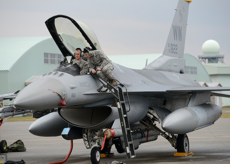 Staff Sgt. Steve Runger and Airman 1st Class Christian Cherven perform operations checks on various F-16 Fighting Falcon systems at Nov. 12, 2014, Komatsu Air Base, Japan. This F-16 is one of several from Misawa Air Base, Japan, participating in the Aviation Training Program at Komatsu. Runger and Cherven are 14th Aircraft Maintenance Unit avionics technicians. (U.S. Air Force photo/Staff Sgt. Alyssa C. Wallace)