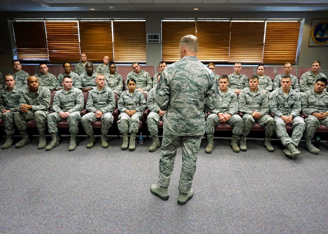 Chief Master Sgt. of the Air Force James Cody addresses Airmen Leadership School class 15-B Nov. 14, 2014, at F.E. Warren Air Force Base, Wyo. Cody stated to the class that the Air Force is unique as it invests time and money into the three important areas: training, education and experience; which help create Airmen who are prepared and extremely capable. (U.S. Air Force photo/Lan Kim)