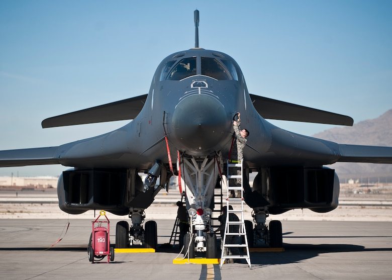 Crew chiefs from the 34th Aircraft Maintenance Unit perform a pre-flight inspection on a B-1B Lancer Nov. 18, 2014, during Green Flag-West 15-02 at Nellis Air Force Base, Nev. Green Flag is typically a joint exercise involving multi-role fighters and/or bomber squadrons, unmanned aircraft, electronic warfare aircraft and aerial refueling aircraft. (U.S. Air Force photo/Staff Sgt. Siuta B. Ika)