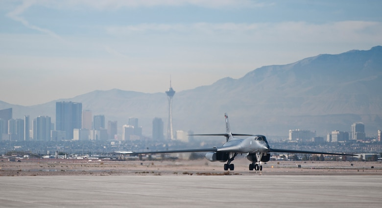 A B-1B Lancer taxis to its parking spot after landing Nov. 18, 2014, during Green Flag-West 15-02 at Nellis AFB, Nev. The B-1's blended body configuration, variable-geometry wings and turbofan afterburning engines combine to provide long range employment, maneuverability and high speed while enhancing survivability. The B-1B is assigned to the 34th Bomb Squadron, at Ellsworth Air Force Base, S.D. (U.S. Air Force photo/Staff Sgt. Siuta B. Ika)