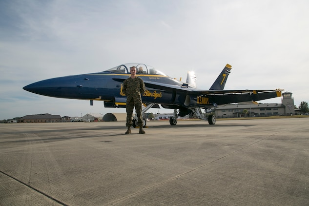 Sergeant Casey Hourigan , an airframes mechanic with Marine Fighter Attack Squadron 312 aboard Marine Corps Air Station Beaufort, checks into the Navy Flight Demonstration Squadron, also known as the Blue Angels, in Pensacola, Fla., Dec. 8.