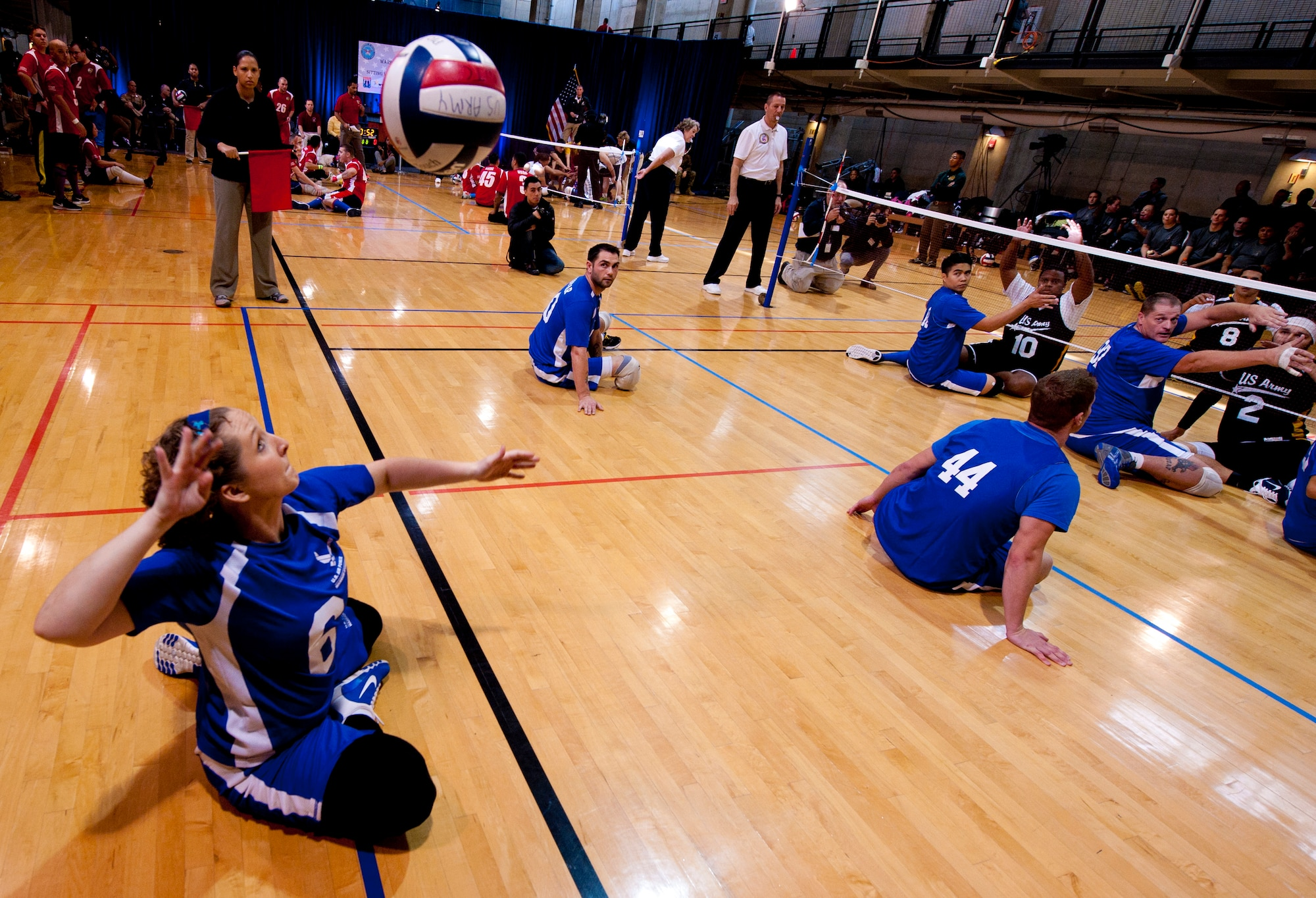 Staff Sgt. Melissa Moreau serves the volleyball during the 4th Annual Pentagon Sitting Volleyball Tournament Nov. 20, 2014, at the Pentagon Athletic Club.  In conjunction with Warrior Care Month, wounded warriors from each service's warrior transition units, as well as U.S. Special Operations Command, participated in the tournament. (U.S. Air Force photo/Staff Sgt. Anthony Nelson Jr.)