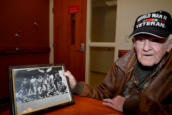 Retired Chief Master Sgt. Blaine Yelton displays a photo of his crew, Nov. 12, 2014, at Joint Base Charleston, S.C. Yelton, now 99 years old, served in the Army Air Corps during World War II and in the Air Force during the wars in Korea and Vietnam. (U.S. Air Force photo/Eric Sesit)