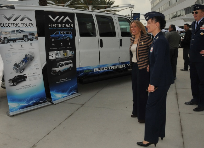 Assistant Secretary of the Air Force for Installations, Environment and Energy Miranda Ballentine visits LAAFB for the unveiling of the base's the plug-in electric vehicle fleet, Nov 14. She is joined by SMC Vice Commander Maj. Gen. Robert McMurry and 61st Air Base Group Commander Col. Donna Turner in viewing the displays of the vehicles and charging systems.  The all-electric/hybrid fleet is the first of its kind in the Department of Defense and will serve as a year-long test for potential expansion throughout DoD.  (Photo by Sarah Corrice)