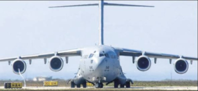 C-17 (shown) and C-130 aircraft will be used for the transport isolation system. (Air Force photo)
