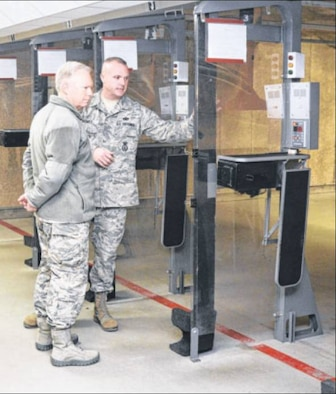 Sgt Bowes shows Lt. Gen. Thompson the indoor firing range and explains the uses of the range for different weapons during the general's visit. (Air Force Photos by Wesley Farnsworth)