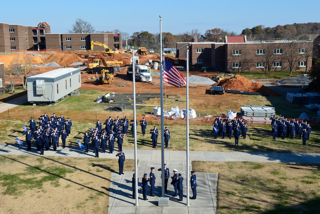 MCGHEE TYSON AIR NATIONAL GUARD BASE, Tenn. - Campus construction here  serves as the backdrop for a retreat ceremony with NCO Academy and Airman Leadership School graduates Nov. 20 at the I.G. Brown Training and Education Center. (U.S. Air National Guard photo by Master Sgt. Jerry Harlan/Released)