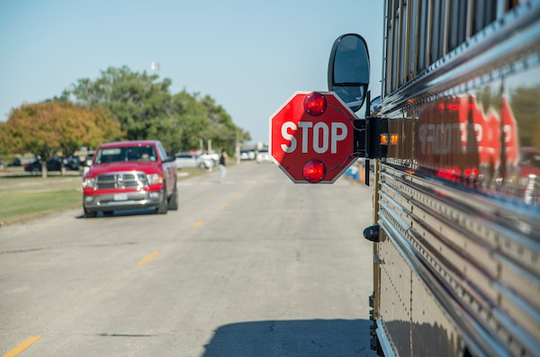The 902nd Security Forces Squadron is stepping up its patrols because of speeding problems that pose safety risks to children boarding school buses at Joint Base San Antonio, Texas.  School buses use yellow flashing lights to alert motorists that they are preparing to stop to load or unload children. Red flashing lights and an extended stop sign signals to motorists that the bus is stopped and children are getting on or off the bus. It is illegal in any state to pass a school bus that is stopped to load or unload children. In addition to this, drivers are urged to always watch for children crossing traffic lanes, observe school zone speed limits, instructions of crossing guards and use caution when traveling through school zones or near routes used by children.