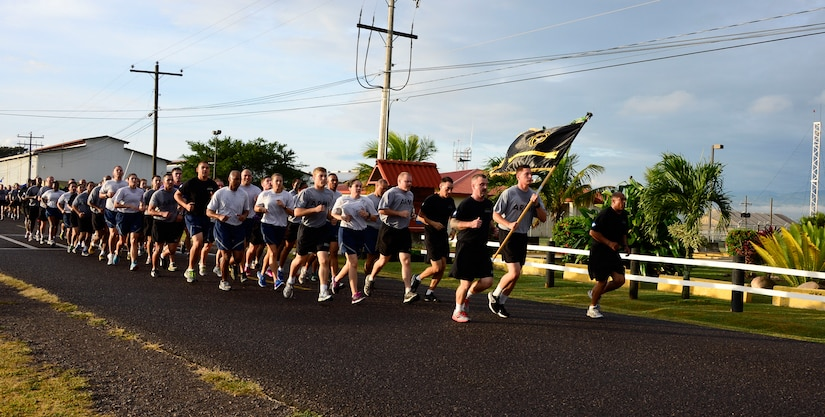 Members of Joint Task Force-Bravo run in formation during the quarterly JTF-Bravo four-mile run at Soto Cano Air Base, Honduras, Nov. 21, 2014.  Once a quarter JTF-Bravo holds a formation run to encourage esprit de corps and physical fitness. (U.S. Air Force photo/Tech. Sgt. Heather Redman)